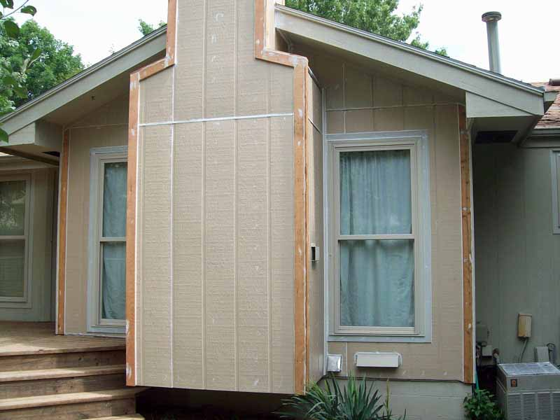 Vertical Georgia-Pacific Siding Installed and all seams and punctured nails caulked