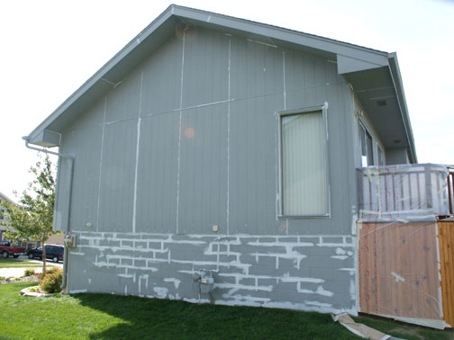 House Siding with Oil-Based Primer and Foundation with Concrete Masonry Primer