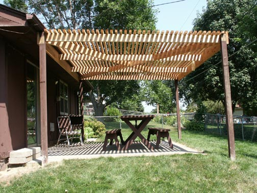 Cedar Pergola is Decay resistant, waiting to dry out prior to staining